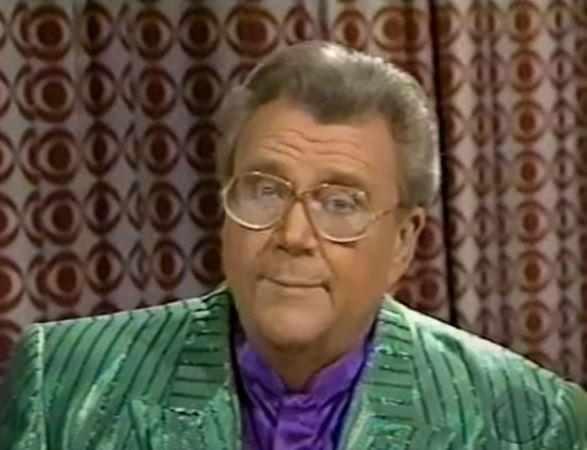 Rod is wearing a green/dark-green striped shiny jacket & purple silk collarless shirt