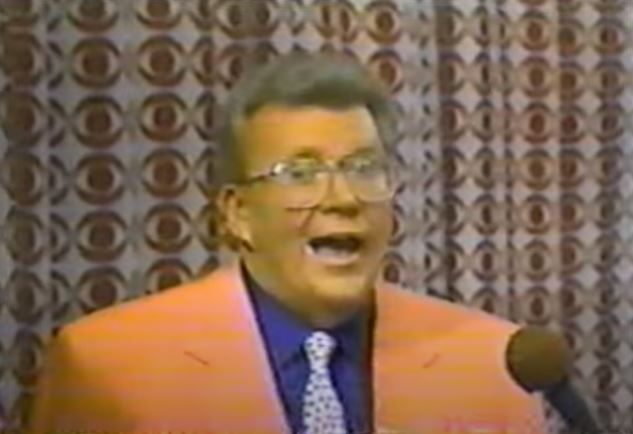 Rod is wearing a Peach-colored jacket, dark blue shirt & polka-doted tie