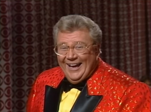 Rod is wearing a Red Jacket w/ gold accents & black lapels, yellow shirt & black bow-tie