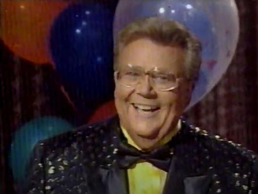 Rod is wearing a black 'mottled' jacket, black bow-tie & yellow silk shirt